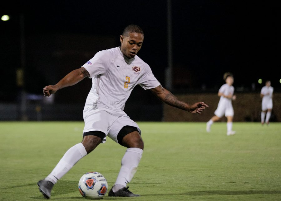 Mechanical engineering junior and defender Sebastian Kennedy dribbles the ball