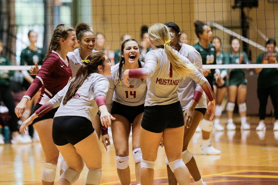 The Stangs celebrate a won rally against Eastern New Mexico