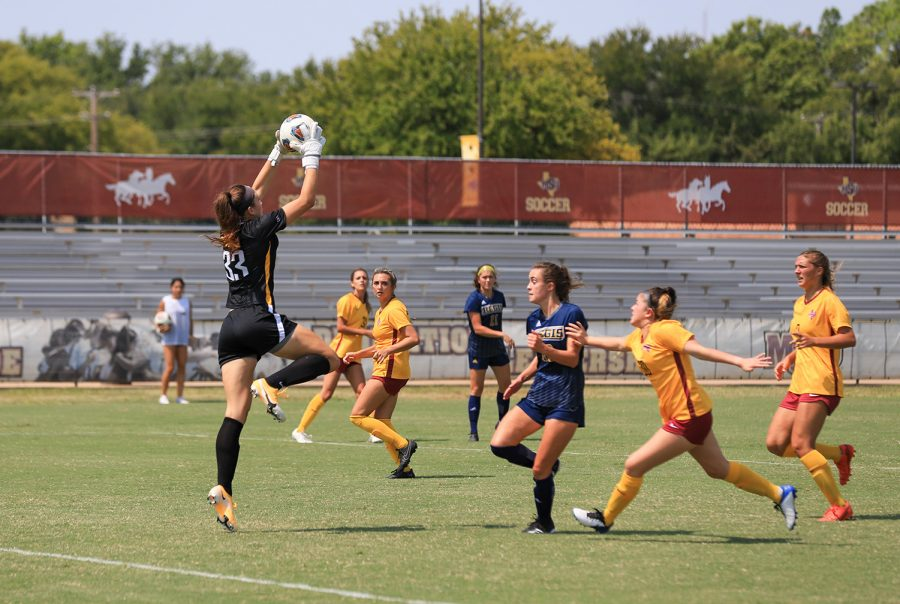 Sports and leisure studies senior and goalkeeper Taylor Camp catches a shot from Regis