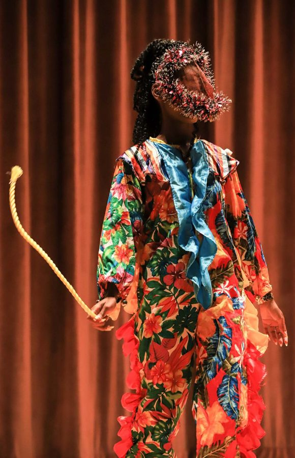 Biology senior Tishauna Perkins performs while dressed in traditional Neveisian wear at the Culture Show.