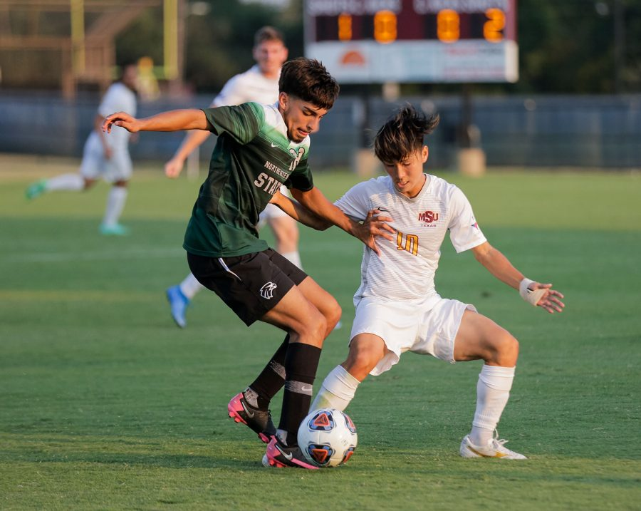 Sport and leisure studies senior and forward Toi Yamaoka fights for the ball against a Northeastern State player