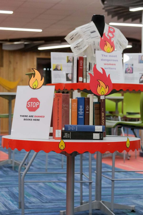 The Banned Books display in Moffet Library encourages students to stay aware of censorship in literature and showcases various banned books throughout history.