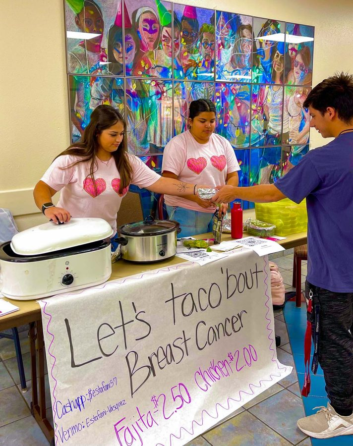 Social work junior Sabrina Ince and english senior Veronica Flores sell tacos to raise awareness for breast cancer with Sigma Lambda Alpha.