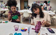 Nursing sophomore Dagmawit Getaneh and nursing freshman Amerti Gonfa create sculptures inspired by alebrijes at the Día de Los Muertos.
