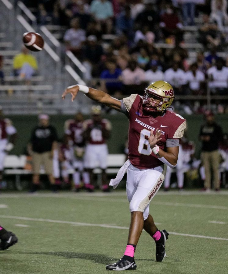 Masters of sports administration senior and quarterback Dillon Sterling-Cole passes the ball to a teammate downfield.