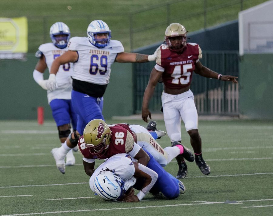 Criminal justice senior and safety Michael Gardner tackles an opposing Texas A&M Kingsville player to prevent him from reaching the goal.