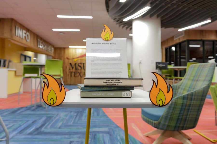 The Banned Books display in Moffet Library discusses the history of banned literature and how books were burned as part of it.