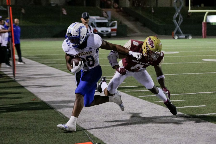Masters of sports administration senior and defensive back Malik Sonnier forces an opposing Texas A&M Kingsville player out of bounds before the first down marker.